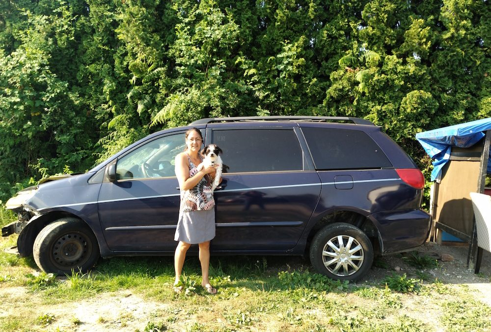 2008 Toyota Sienna donated by Angie, shown in the photo holding her pup Tiny