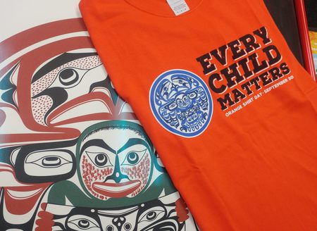 Every Child Matters T Shirt and IRSSS logo