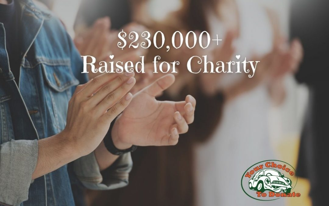 People clapping over dollars raised for charity